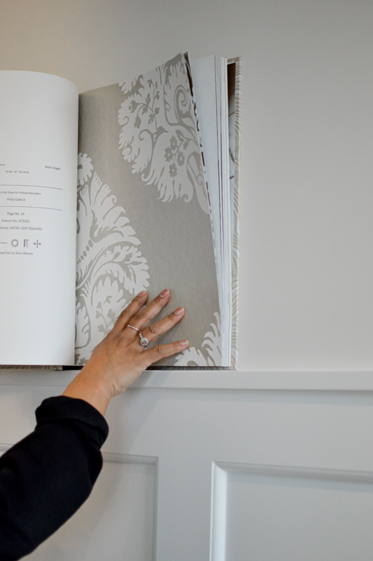 Designer Holding Up Sample to Wall